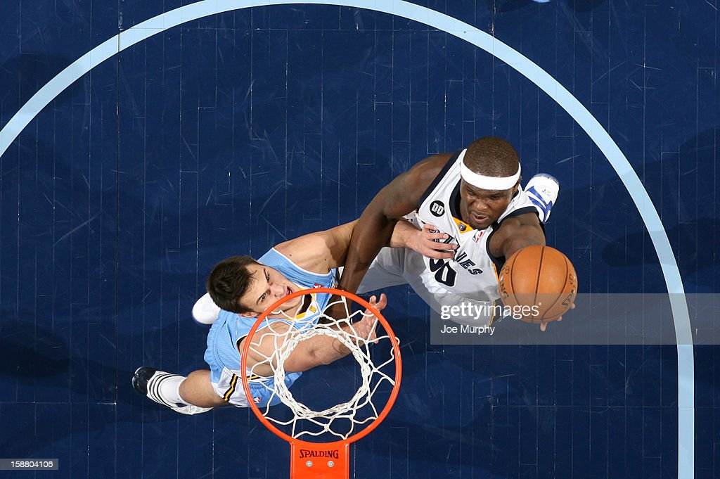 Zach Randolph #50 of the Memphis Grizzlies shoots against Danilo Gallinari #8 of the Denver Nuggets on December 29, 2012 at FedExForum in Memphis, Tennessee.