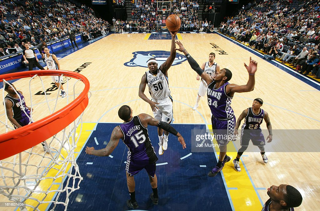 <a gi-track='captionPersonalityLinkClicked' href=/galleries/search?phrase=Zach+Randolph&family=editorial&specificpeople=201595 ng-click='$event.stopPropagation()'>Zach Randolph</a> #50 of the Memphis Grizzlies shoots against <a gi-track='captionPersonalityLinkClicked' href=/galleries/search?phrase=DeMarcus+Cousins&family=editorial&specificpeople=5792008 ng-click='$event.stopPropagation()'>DeMarcus Cousins</a> #15 and Jason Thompson #34 of the Sacramento Kings on February 12, 2013 at FedExForum in Memphis, Tennessee.