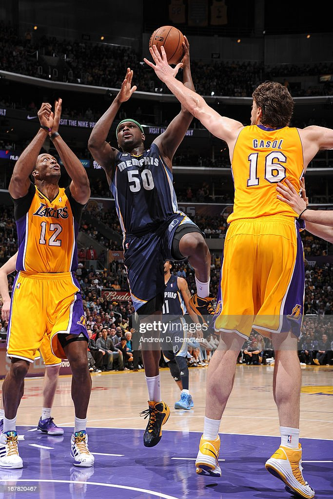 <a gi-track='captionPersonalityLinkClicked' href=/galleries/search?phrase=Zach+Randolph&family=editorial&specificpeople=201595 ng-click='$event.stopPropagation()'>Zach Randolph</a> #50 of the Memphis Grizzlies shoots against <a gi-track='captionPersonalityLinkClicked' href=/galleries/search?phrase=Dwight+Howard&family=editorial&specificpeople=201570 ng-click='$event.stopPropagation()'>Dwight Howard</a> #12 and <a gi-track='captionPersonalityLinkClicked' href=/galleries/search?phrase=Pau+Gasol&family=editorial&specificpeople=201587 ng-click='$event.stopPropagation()'>Pau Gasol</a> #16 of the Los Angeles Lakers at Staples Center on April 5, 2013 in Los Angeles, California.