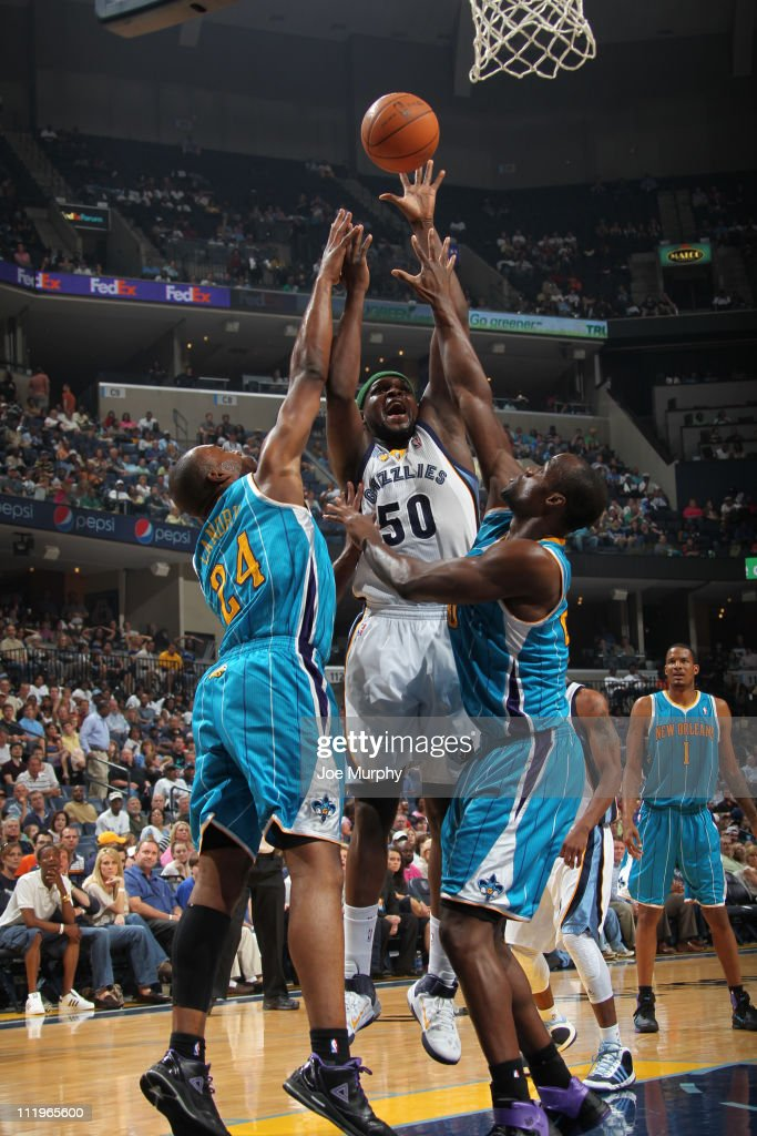 <a gi-track='captionPersonalityLinkClicked' href=/galleries/search?phrase=Zach+Randolph&family=editorial&specificpeople=201595 ng-click='$event.stopPropagation()'>Zach Randolph</a> #50 of the Memphis Grizzlies shoots against <a gi-track='captionPersonalityLinkClicked' href=/galleries/search?phrase=Emeka+Okafor&family=editorial&specificpeople=201739 ng-click='$event.stopPropagation()'>Emeka Okafor</a> #50 and <a gi-track='captionPersonalityLinkClicked' href=/galleries/search?phrase=Carl+Landry&family=editorial&specificpeople=4111952 ng-click='$event.stopPropagation()'>Carl Landry</a> #24 of the New Orleans Hornets during the game on April 10, 2011 at FedExForum in Memphis, Tennessee.