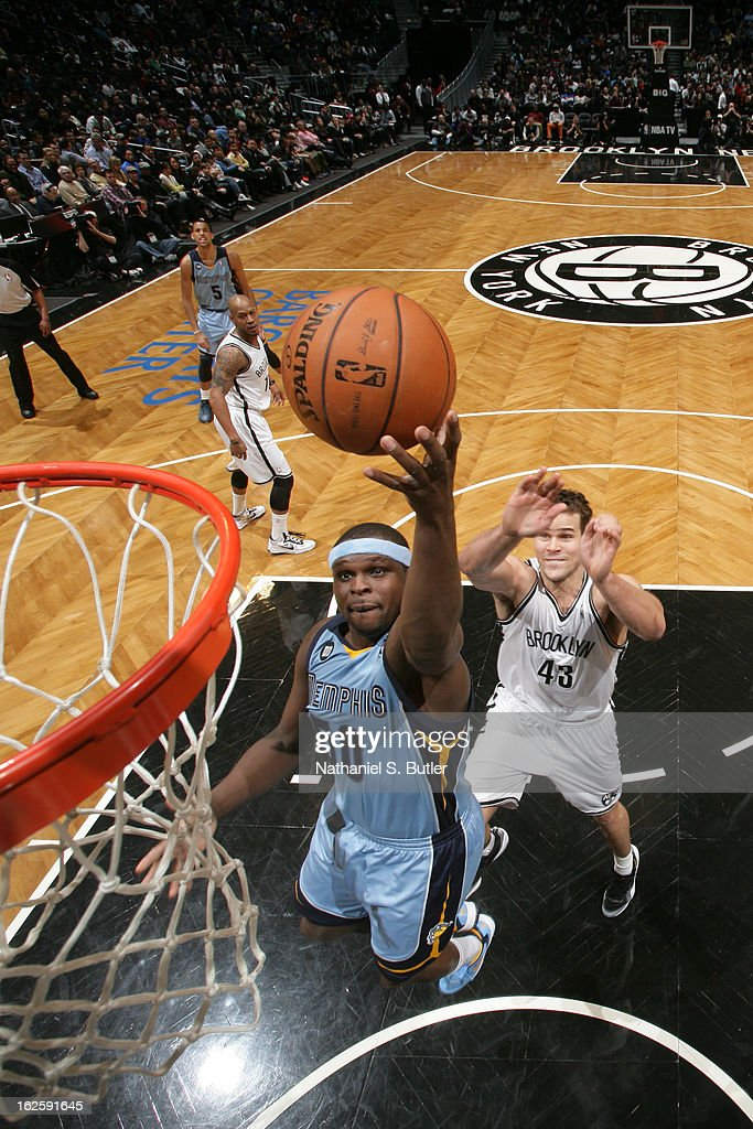 Zach Randolph #50 of the Memphis Grizzlies shoots against Kris Humphries #43 of the Brooklyn Nets on February 24, 2013 at the Barclays Center in the Brooklyn borough of New York City.