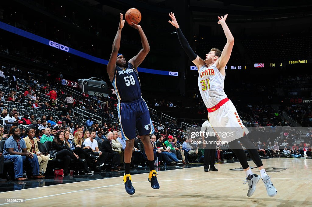 <a gi-track='captionPersonalityLinkClicked' href=/galleries/search?phrase=Zach+Randolph&family=editorial&specificpeople=201595 ng-click='$event.stopPropagation()'>Zach Randolph</a> #50 of the Memphis Grizzlies shoots against <a gi-track='captionPersonalityLinkClicked' href=/galleries/search?phrase=Mike+Muscala&family=editorial&specificpeople=7563430 ng-click='$event.stopPropagation()'>Mike Muscala</a> #31 of the Atlanta Hawks on October 21, 2015 at Philips Arena in Atlanta, Georgia.