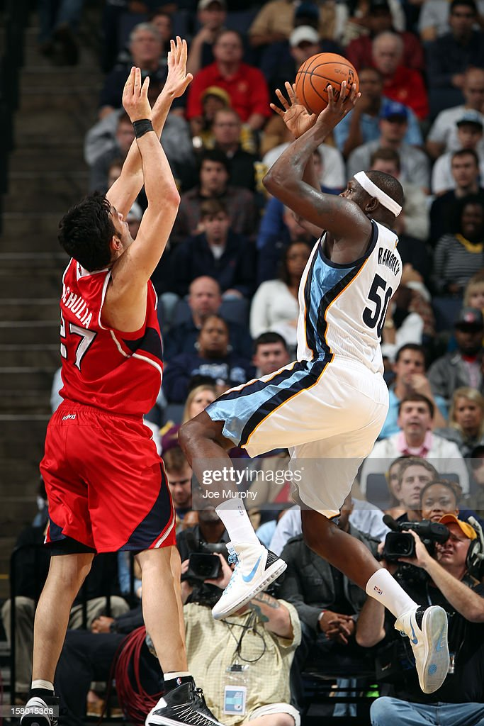 <a gi-track='captionPersonalityLinkClicked' href=/galleries/search?phrase=Zach+Randolph&family=editorial&specificpeople=201595 ng-click='$event.stopPropagation()'>Zach Randolph</a> #50 of the Memphis Grizzlies shoots against <a gi-track='captionPersonalityLinkClicked' href=/galleries/search?phrase=Zaza+Pachulia&family=editorial&specificpeople=202939 ng-click='$event.stopPropagation()'>Zaza Pachulia</a> #27 of the Atlanta Hawks on December 8, 2012 at FedExForum in Memphis, Tennessee.