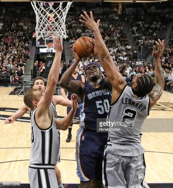 Zach Randolph of the Memphis Grizzlies shoots between David Lee of the San Antonio Spurs and Kawhi Leonard of the San Antonio Spurs in Game One of...