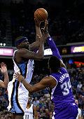 Zach Randolph of the Memphis Grizzlies shoots over Jason Thompson of the Sacramento Kings at Sleep Train Arena on February 25 2015 in Sacramento...
