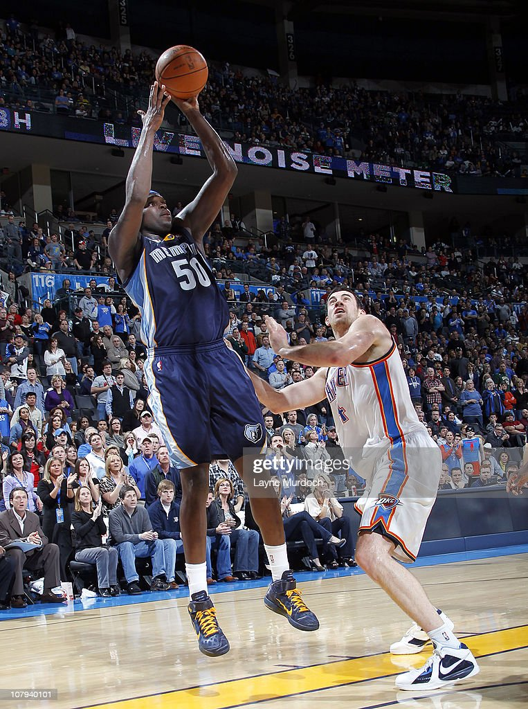 Zach Randolph #50 of the Memphis Grizzlies shoots over Nick Collison #4 of the Oklahoma City Thunder on January 8, 2011 at the Ford Center in Oklahoma City, Oklahoma.