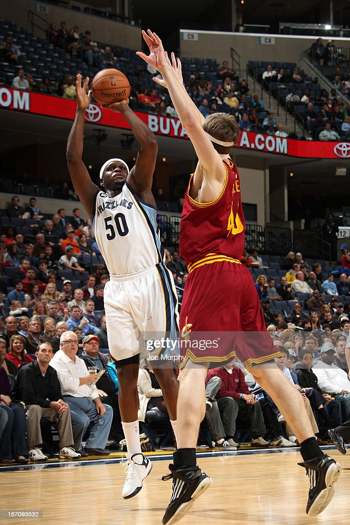 <a gi-track='captionPersonalityLinkClicked' href=/galleries/search?phrase=Zach+Randolph&family=editorial&specificpeople=201595 ng-click='$event.stopPropagation()'>Zach Randolph</a> #50 of the Memphis Grizzlies shoots the ball against <a gi-track='captionPersonalityLinkClicked' href=/galleries/search?phrase=Tyler+Zeller&family=editorial&specificpeople=5122156 ng-click='$event.stopPropagation()'>Tyler Zeller</a> #40 of the Cleveland Cavaliers on November 26, 2012 at FedExForum in Memphis, Tennessee.
