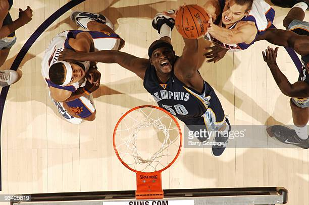 Zach Randolph of the Memphis Grizzlies tries to get a rebound away from Louis Amundson of the Phoenix Suns in an NBA Game played on November 25 2009...