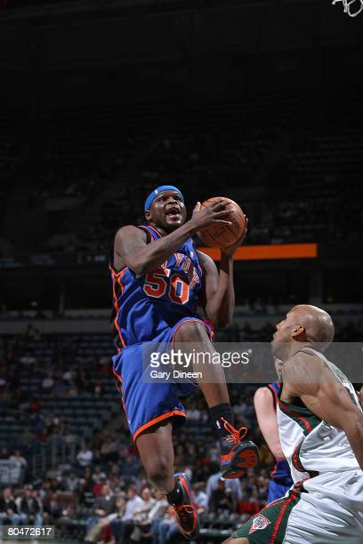 Zach Randolph of the New York Knicks drives to the basket against Michael Ruffin of the Milwaukee Bucks on April 1 2008 at the Bradley Center in...