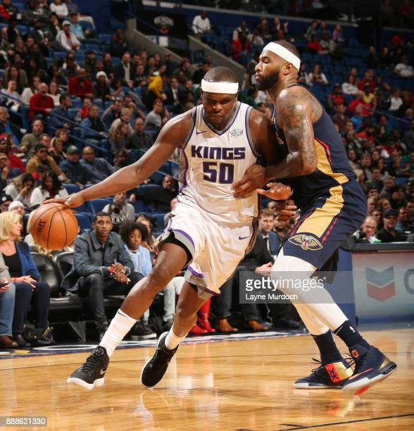 Zach Randolph of the Sacramento Kings handles the ball against DeMarcus Cousins of the New Orleans Pelicans on December 8 2017 at Smoothie King...