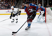 Zach Redmond of the Colorado Avalanche controls the puck at Pepsi Center on March 4 2015 in Denver Colorado The Avalanche defeated the Penguins 31