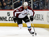 Zach Redmond of the Colorado Avalanche plays the puck up the ice during first period action against the Winnipeg Jets at the MTS Centre on January 18...