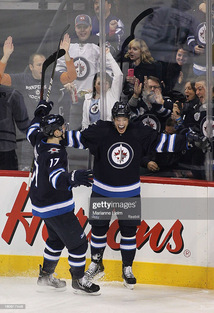 Zach Redmond #25 of the Winnipeg Jets celebrates his first goal as a Winnipeg Jet as teammate James Wright #17 skates in to congratulate him in a game against the Toronto Maple Leafs during second-period action on February 7, 2013 at the MTS Centre in Winnipeg, Manitoba, Canada.