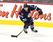 Zach Redmond of the Winnipeg Jets prepares to pass the puck during first period action in an NHL game against the Calgary Flames at the MTS Centre on...