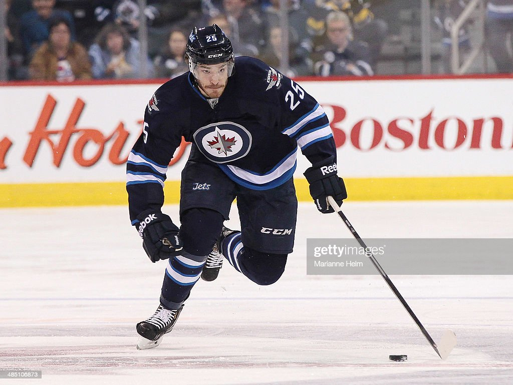 Zach Redmond #25 of the Winnipeg Jets skates down the ice during the second period of the NHL game against the Boston Bruins at the MTS Centre on April 10, 2014 in Winnipeg, Manitoba, Canada.