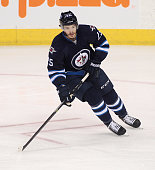 Zach Redmond of the Winnipeg Jets skates down the ice during the first period of the NHL game against the Boston Bruins at the MTS Centre on April 10...