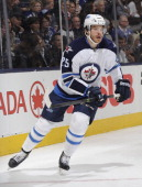 Zach Redmond of the Winnipeg Jets skates during NHL game action against the Toronto Maple Leafs April 5 2014 at the Air Canada Centre in Toronto...