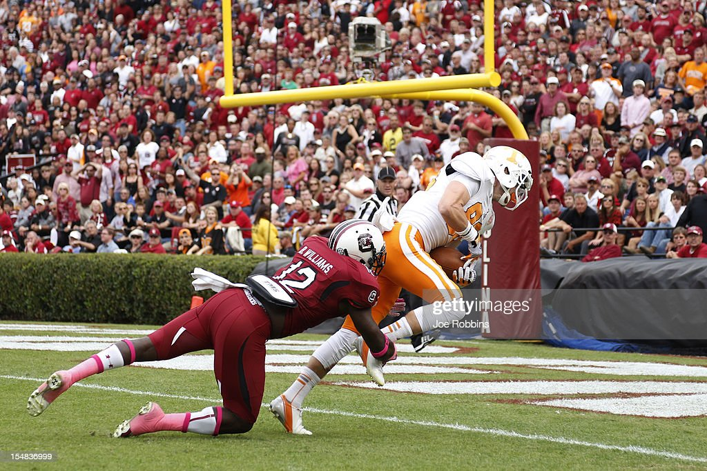 Zach Rogers #83 of the Tennessee Volunteers crosses the goal line after a 37-yard touchdown in the second quarter ahead of Brison Williams #12 of the South Carolina Gamecocks during the game at Williams-Brice Stadium on October 27, 2012 in Columbia, South Carolina.