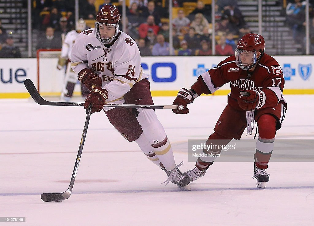 Zach Sanford of the Boston College Eagles skates against Sean Malone of the Harvard Crimson during the third period of the 2015 Beanpot Tournament...