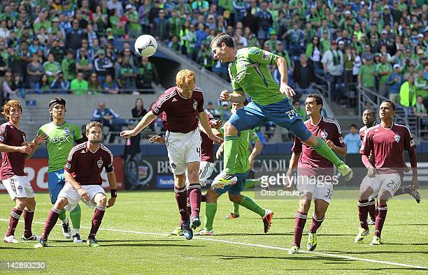 Zach Scott of the Seattle Sounders heads in a corner kick for a goal against the Colorado Rapids at CenturyLink Field on April 14 2012 in Seattle...