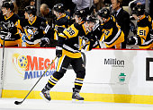 Zach Sill of the Pittsburgh Penguins celebrates his first National Hockey League goal in the second period during the game against the Chicago...