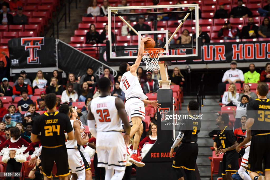 Zach Smith #11 of the Texas Tech Red Raiders dunks the basketball during the game against the Kennesaw State Owls on December 13, 2017 at United Supermarkets Arena in Lubbock, Texas. Texas Tech defeated Kennesaw State 82-53.
