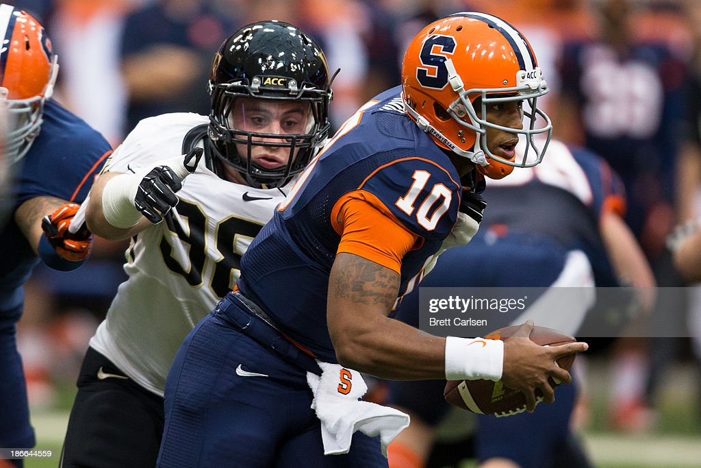Zach Thompson #98 of Wake Forest Demon Deacons pursues Terrell Hunt #10 of Syracuse Orange during the first quarter on November 2, 2013 at the Carrier Dome in Syracuse, New York. Syracuse shuts out Wake Forest 13-0