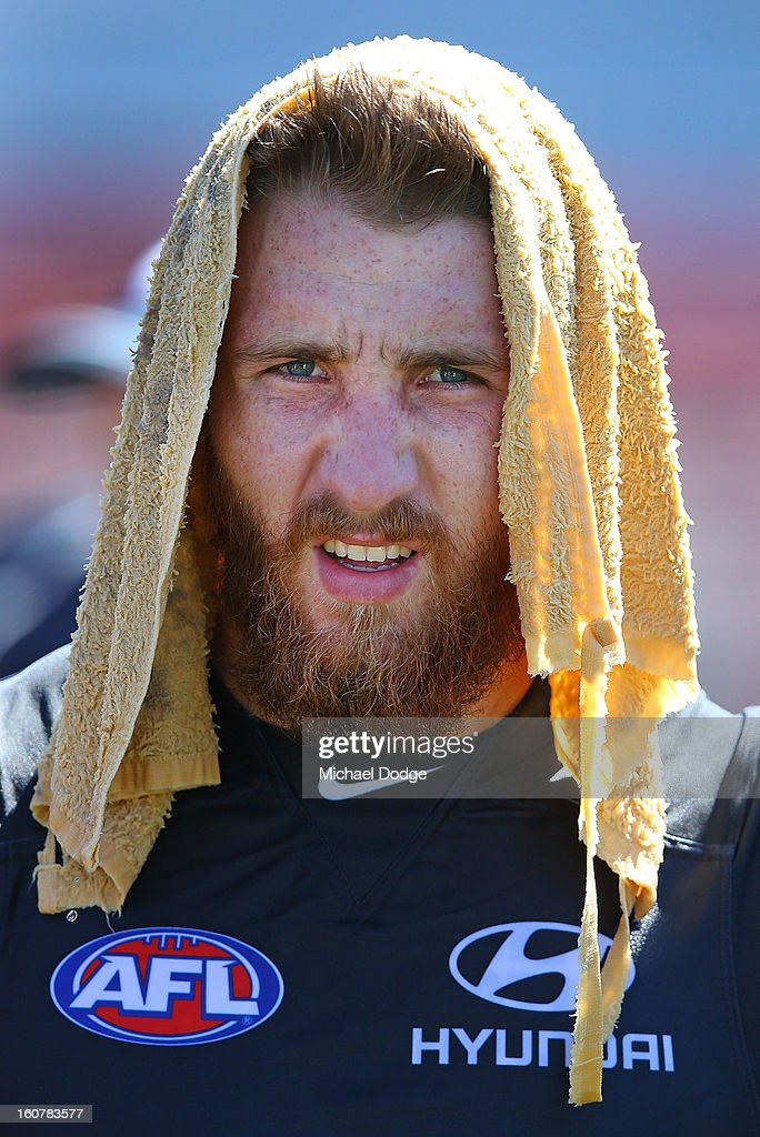 Zach Tuohy cools down with a wet towel during a Carlton Blues AFL Intra-Club match at Visy Park on February 6, 2013 in Melbourne, Australia.
