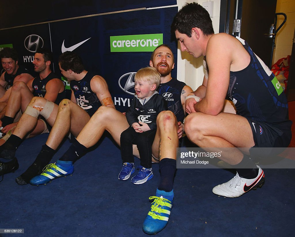 Zach Tuohy of the Blues celebrates the win with his son during the round 10 AFL match between the Carlton Blues and the Geelong Cats at Etihad Stadium on May 29, 2016 in Melbourne, Australia.
