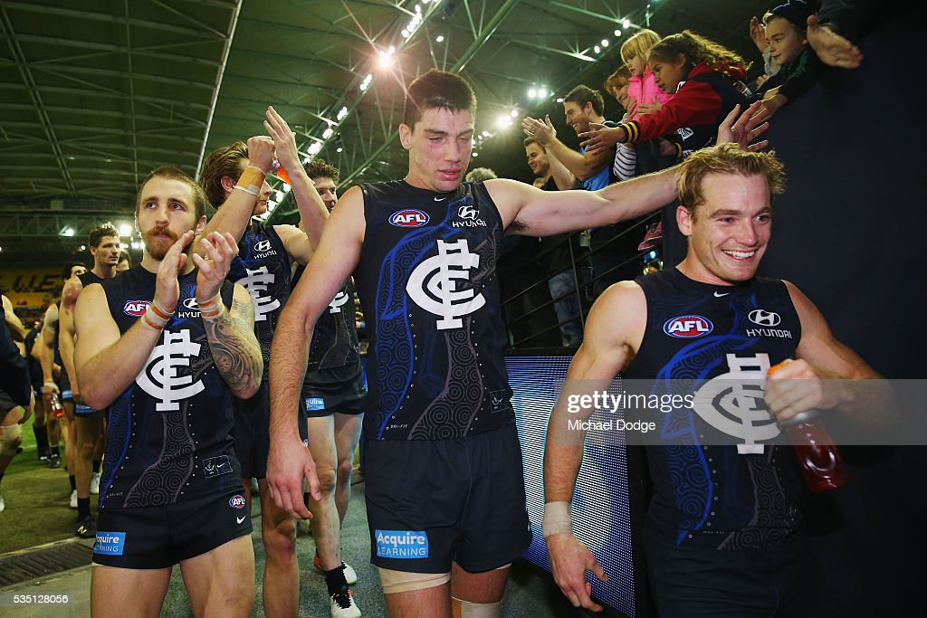 Zach Tuohy of the Blues (L) Matthew Kreuzer (C) and Sam Kerridge of the Blues during the round 10 AFL match between the Carlton Blues and the Geelong Cats at Etihad Stadium on May 29, 2016 in Melbourne, Australia.