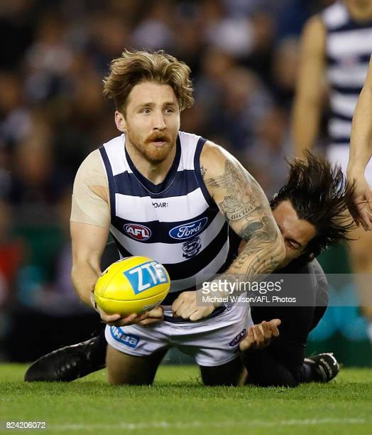 Zach Tuohy of the Cats is tackled by Jack Silvagni of the Blues in action during the 2017 AFL round 19 match between the Carlton Blues and the...