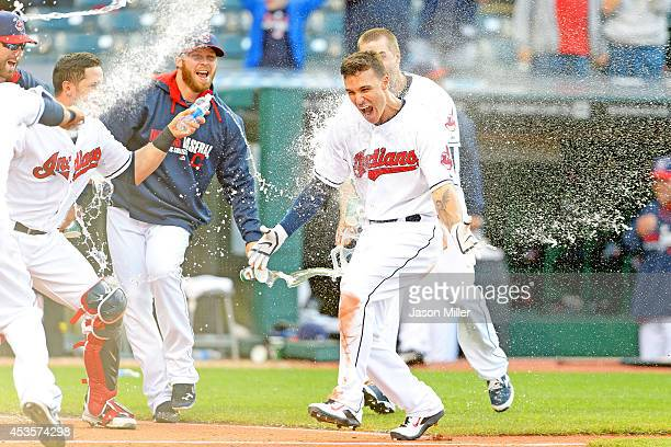 Zach Walters of the Cleveland Indians celebrates after hitting a walkoff solo home run during the ninth inning against the Arizona Diamondbacks at...