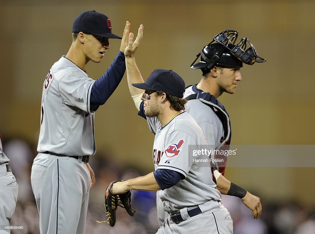 Zach Walters #6, Tyler Holt #62 and <a gi-track='captionPersonalityLinkClicked' href=/galleries/search?phrase=Yan+Gomes&family=editorial&specificpeople=9004037 ng-click='$event.stopPropagation()'>Yan Gomes</a> #10 of the Cleveland Indians celebrate a win of the game against the Minnesota Twins on August 19, 2014 at Target Field in Minneapolis, Minnesota. The Indians defeated the Twins 7-5.
