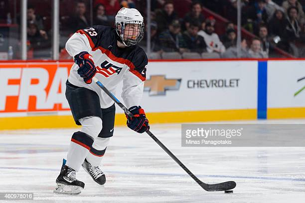 Zach Werenski of Team United States looks to pass the puck during the 2015 IIHF World Junior Hockey Championship game against Team Germany at the...