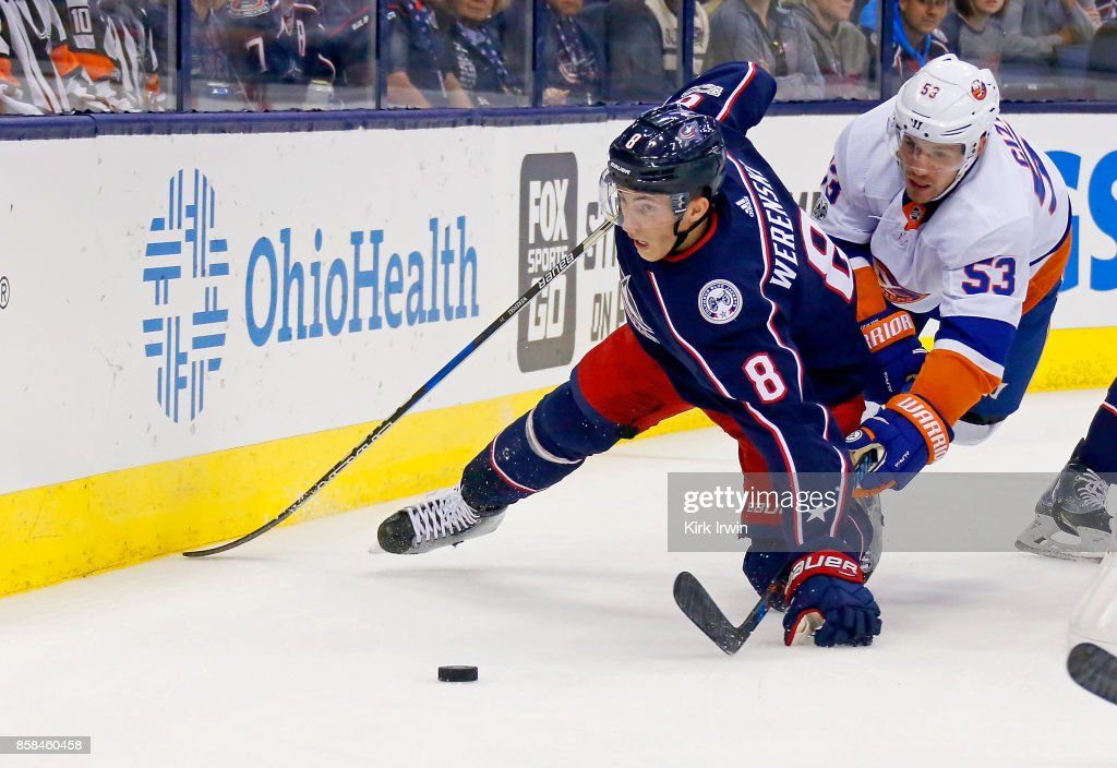 Zach Werenski #8 of the Columbus Blue Jackets and Casey Cizikas #53 of the New York Islanders battle for control of the puck during the first period on October 6, 2017 at Nationwide Arena in Columbus, Ohio.