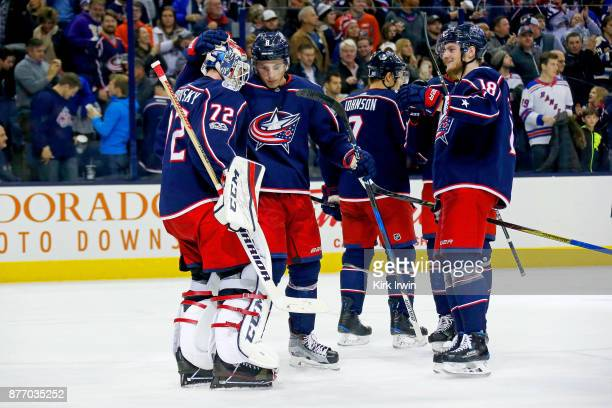 Zach Werenski of the Columbus Blue Jackets and PierreLuc Dubois of the Columbus Blue Jackets congratulate Sergei Bobrovsky of the Columbus Blue...