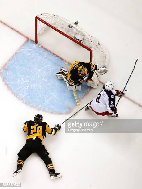 Zach Werenski of the Columbus Blue Jackets can't get a shot off between Ian Cole and MarcAndre Fleury of the Pittsburgh Penguins in Game Two of the...