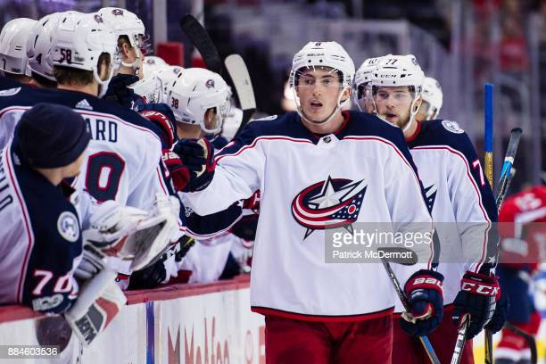 Zach Werenski of the Columbus Blue Jackets celebrates after scoring a third period goal against the Washington Capitals at Capital One Arena on...