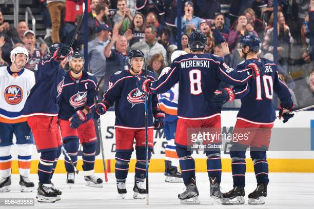 Zach Werenski of the Columbus Blue Jackets celebrates his second period goal with his fellow teammates during a game against the New York Islanders...