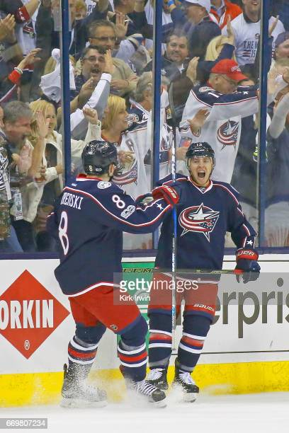 Zach Werenski of the Columbus Blue Jackets congratulates Cam Atkinson of the Columbus Blue Jackets after scoring a goal in Game Three of the Eastern...