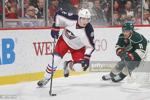 Zach Werenski of the Columbus Blue Jackets controls the puck with Zach Parise of the Minnesota Wild defending during the game on December 31 2016 at...