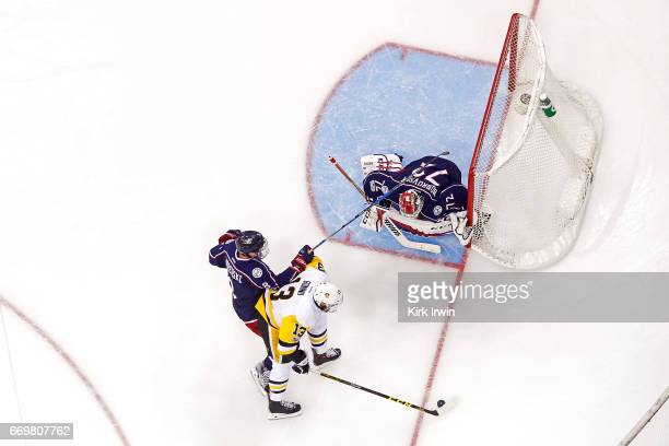 Zach Werenski of the Columbus Blue Jackets directs Nick Bonino of the Pittsburgh Penguins wide of Sergei Bobrovsky of the Columbus Blue Jackets...