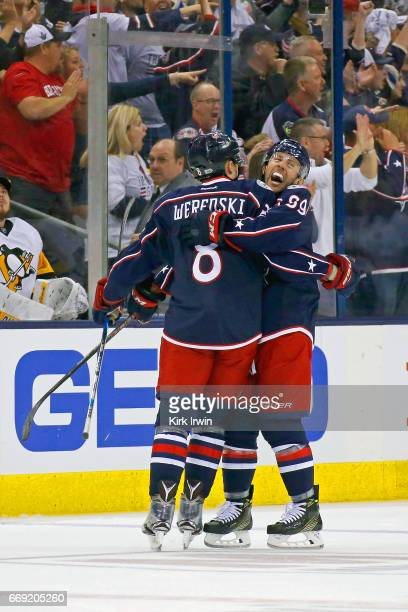 Zach Werenski of the Columbus Blue Jackets is congratulated Sam Gagner after scoring a goal during the first period against the Pittsburgh Penguins...