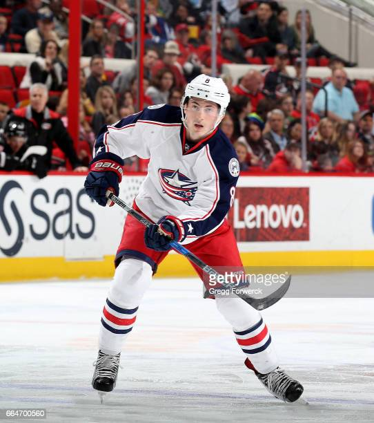 Zach Werenski of the Columbus Blue Jackets passes the puck during an NHL game against the Carolina Hurricanes on March 30 2017 at PNC Arena in...