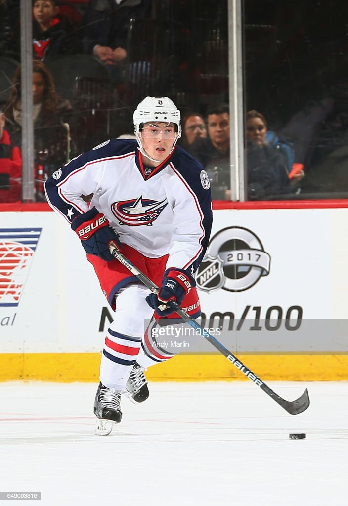 Zach Werenski #8 of the Columbus Blue Jackets plays the puck during the game against the New Jersey Devils at Prudential Center on March 5, 2017 in Newark, New Jersey.