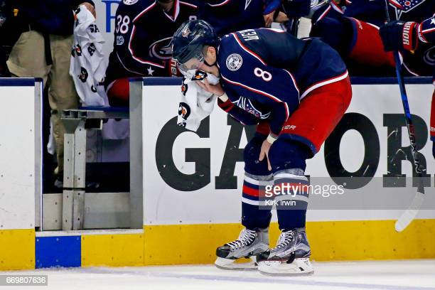 Zach Werenski of the Columbus Blue Jackets skates off of the ice after getting hit in the face with a puck in Game Three of the Eastern Conference...
