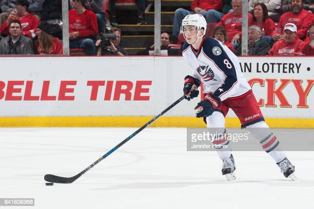 Zach Werenski of the Columbus Blue Jackets skates with the puck up ice during an NHL game against the Detroit Red Wings at Joe Louis Arena on...