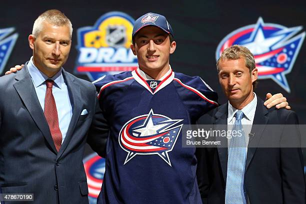 Zach Werenski poses after being selected eighth overall by the Columbus Blue Jackets in the first round of the 2015 NHL Draft at BBT Center on June...