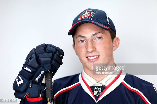 Zach Werenski poses for a portrait after being selected eighth overall by the Columbus Blue Jackets during the 2015 NHL Draft at BBT Center on June...