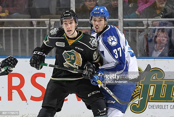 Zach Wilkie of the Sudbury Wolves battles against Alex Formenton of the London Knights during an OHL game at Budweiser Gardens on January 6 2017 in...